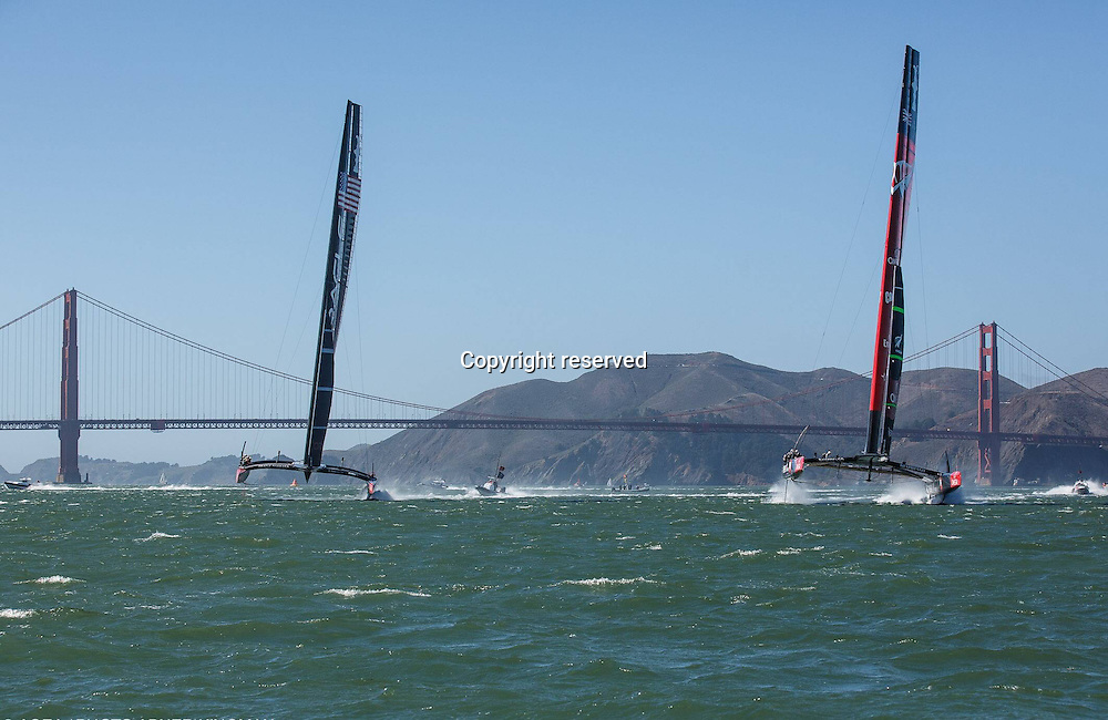 24.09.2013 San Francisco, USA. Oracle Team USA in action against Emirates Team New Zealand during the America's Cup Finals.