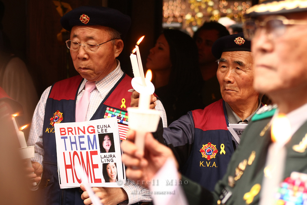 June 03, 2009; Santa Monica, CA - Members of the Korean Veterans Association hold signs and candles at a candlelight vigil at Wokcano for Euna Lee and Laura Ling, two American journalists who have been detained in North Korea for nearly three months...Photo Credit: Darrell Miho