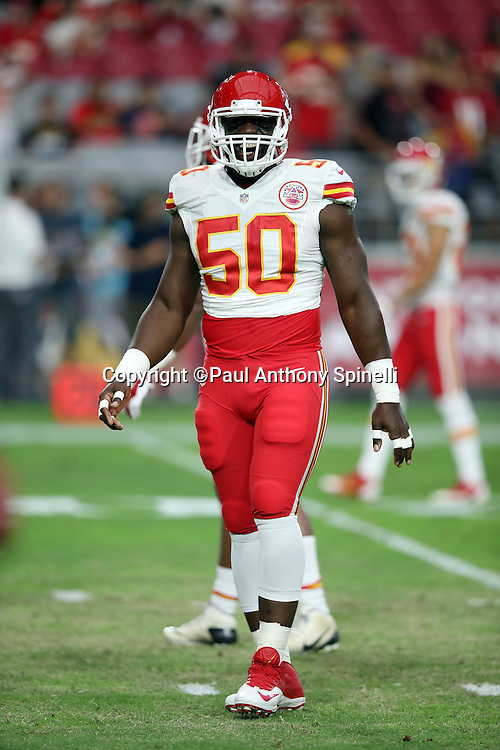 Kansas City Chiefs outside linebacker Justin Houston (50) laughs during the 2015 NFL preseason football game against the Arizona Cardinals on Saturday, Aug. 15, 2015 in Glendale, Ariz. The Chiefs won the game 34-19. (©Paul Anthony Spinelli)