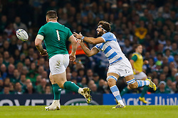 Argentina Flanker Juan Martin Fernandez Lobbe is challenged by Ireland Prop Cian Healy - Mandatory byline: Rogan Thomson/JMP - 07966 386802 - 18/10/2015 - RUGBY UNION - Millennium Stadium - Cardiff, Wales - Ireland v Argentina - Rugby World Cup 2015 Quarter Finals.