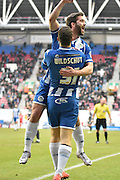 Wigan Athletic Forward, Will Grigg  opens the scoring during the Sky Bet League 1 match between Wigan Athletic and Bury at the DW Stadium, Wigan, England on 27 February 2016. Photo by Mark Pollitt.