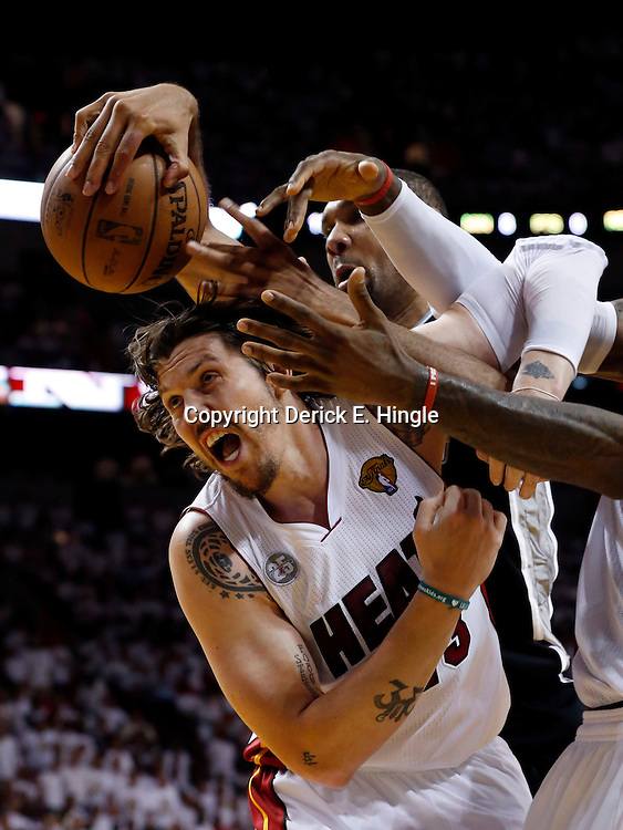 Jun 18, 2013; Miami, FL, USA; Miami Heat shooting guard Mike Miller (left) and San Antonio Spurs power forward Tim Duncan (center) and Miami Heat small forward LeBron James (right) go after a loose ball during the third quarter of game six in the 2013 NBA Finals at American Airlines Arena.  Mandatory Credit: Derick E. Hingle-USA TODAY Sports