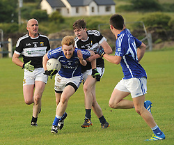 Kilmeena&rsquo;s Sean Ryder tackles Killala&rsquo;s David Lowther during the junior championship match on saturday evening last.<br />