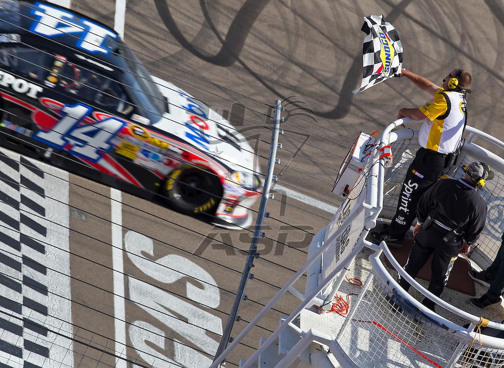 LAS VEGAS, NV - MAR 11, 2012:  Tony Stewart (14) drives his Mobil 1 Chevrolet into Victory Lane, winning the Kobalt Tools 400 race at the Las Vegas Motor Speedway in Las Vegas, NV.