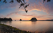 A panorama of the sunset at the mouth of the Quillayute River where it meets the sea at La Push Washington.  On the shore of Olympic National Park.