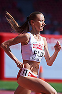 Renata Plis of Poland competes in women's 1500 meters qualification during the First Day of the European Athletics Championships Zurich 2014 at Letzigrund Stadium in Zurich, Switzerland.<br /> <br /> Switzerland, Zurich, August 12, 2014<br /> <br /> Picture also available in RAW (NEF) or TIFF format on special request.<br /> <br /> For editorial use only. Any commercial or promotional use requires permission.<br /> <br /> Photo by © Adam Nurkiewicz / Mediasport