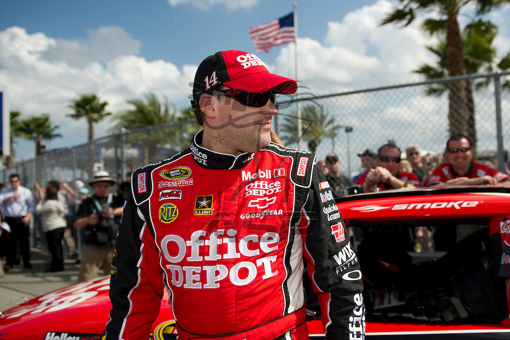 Daytona Beach, FL - FEB 19, 2012: Tony Stewart (14) gets out of the car during qualifying for the Daytona 500 at the Daytona International Speedway in Daytona Beach, FL.