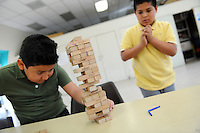 Tony Castro, left, is cool and calm while Jovanny Melo&rsquo;s body language says it all during their after-school game of Jenga at the Hebbron Family Center on Monday. The boys are both 10, and in the fifth-grade at Loma Vista Elementary School in Salinas.  <br /> <br /> Jenga is a game of patience and dexterity, quite popular since its introduction to the USA in the mid-1980s. The name Jenga is from Swahili, meaning &ldquo;to build.&rdquo; The trick, of course, is not only to remove a tile from the original tower of 54, but to replace it at the top, creating an increasingly unstable structure until&hellip; <br /> <br /> Kids visiting the Hebbron Family Center can get help with their homework from staff, play games, use the computers, take karate classes, and join a variety of other enrichment activities throughout the year. <br /> <br /> The City of Salinas Recreation-Park Division offers free after school programs for youth at several of its recreation facilities Monday - Friday between the hours of 3:00 p.m. - 5:30 p.m. These programs offer a safe, fun and positive environment for youth. For more information, please visit http://www.ci.salinas.ca.us/services/recreation/kids_programs.cfm