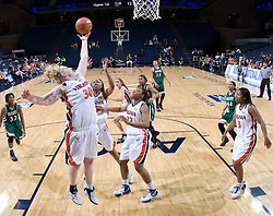 Virginia Cavaliers Forward/Center Abby Robertson (30) grabs a rebound against Charlotte.  The Virginia Cavaliers women's basketball team defeated The University of North Carolina - Charlotte 49ers 74-72 in the 2nd round of the Women's NIT at John Paul Jones Arena in Charlottesville, VA on March 19, 2007.