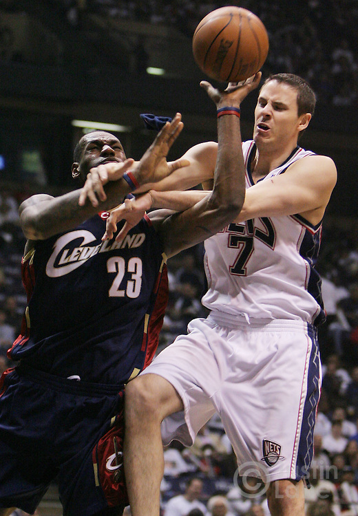 The Cavaliers' LeBron James (L) battles the Nets' Bostian Nachbar (R) during the first half of game 6 of the Eastern Conference semifinals between the Cleveland Cavaliers and the New Jersey Nets at Continental Airlines Arena in East Rutherford, New Jersey on 18 May 2007.