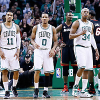 27 January 2013: Boston Celtics shooting guard Courtney Lee (11), Boston Celtics point guard Avery Bradley (0) and Boston Celtics small forward Paul Pierce (34) are seen during the Boston Celtics 100-98  2OT victory over the Miami Heat at the TD Garden, Boston, Massachusetts, USA.