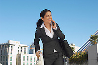 Businesswoman talking on mobile phone outdoors