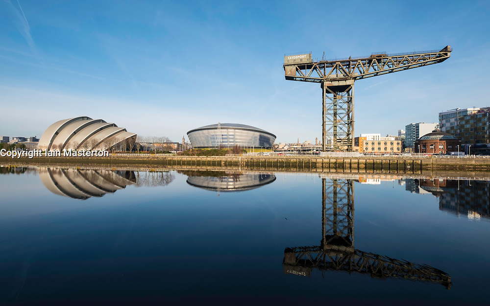 View of Finnieston Crane, SEC Armadillo and SSE Hydro arena beside River Clyde on blue sky winter day, Scotland, United Kingdom