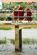 12 JUNE 2013 - YANGON, MYANMAR:  Burmese Buddhist novices at the end of the day on a pier on the Irrawaddy River in Yangon, Myanmar.        PHOTO BY JACK KURTZ