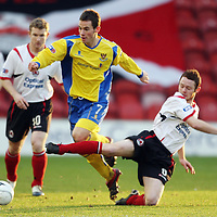 Clyde v St Johnstone....29.12.07 <br /> Kevin Moon skips a tackle by Ruari MacLennan<br /> Picture by Graeme Hart.<br /> Copyright Perthshire Picture Agency<br /> Tel: 01738 623350  Mobile: 07990 594431