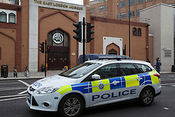© licensed to London News Pictures. London, UK 10/06/2013. Police cars patrolling outside The East London Mosque on Monday, 10 July 2013. Photo credit: Tolga Akmen/LNP