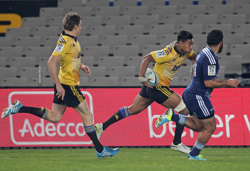 Hurricanes' Julian Savea supported by  Beauden Barrett runs past Blues' Piri Weepu to score a try in a Super Rugby match, Eden Park, Auckland, New Zealand, Saturday, May 31, 2014.  Credit:SNPA / David Rowland