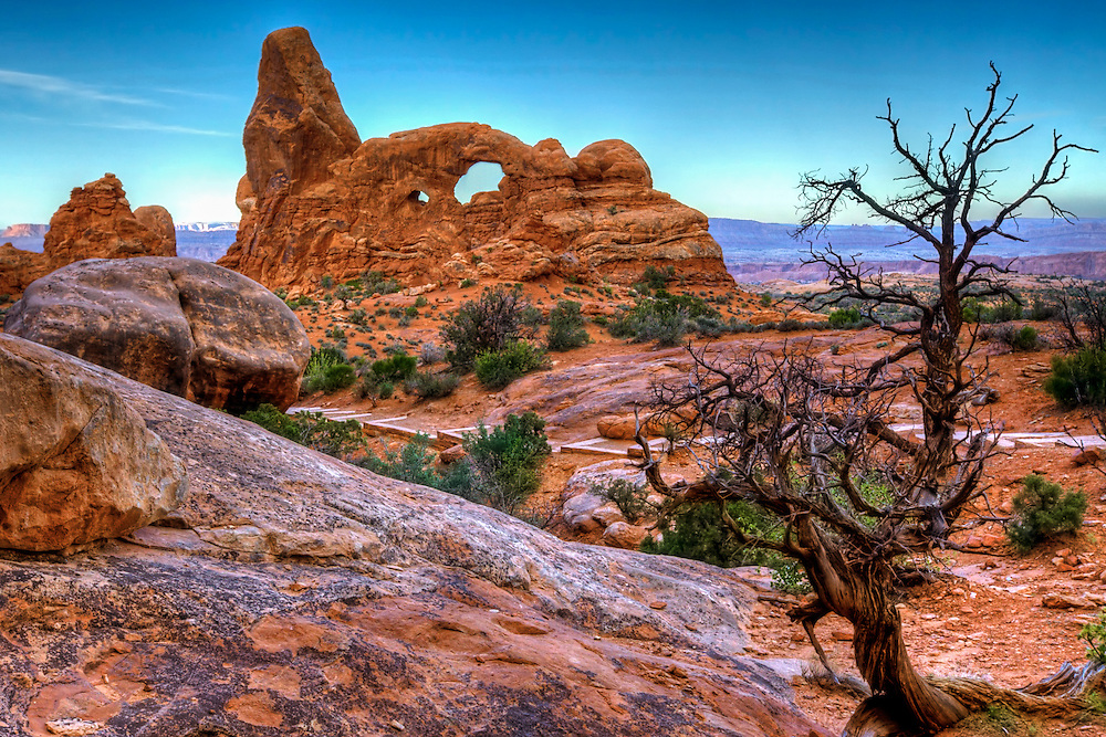 A beautiful dawn, and the advancing day as seen from Turret Arch in the windows section of Arches National Park