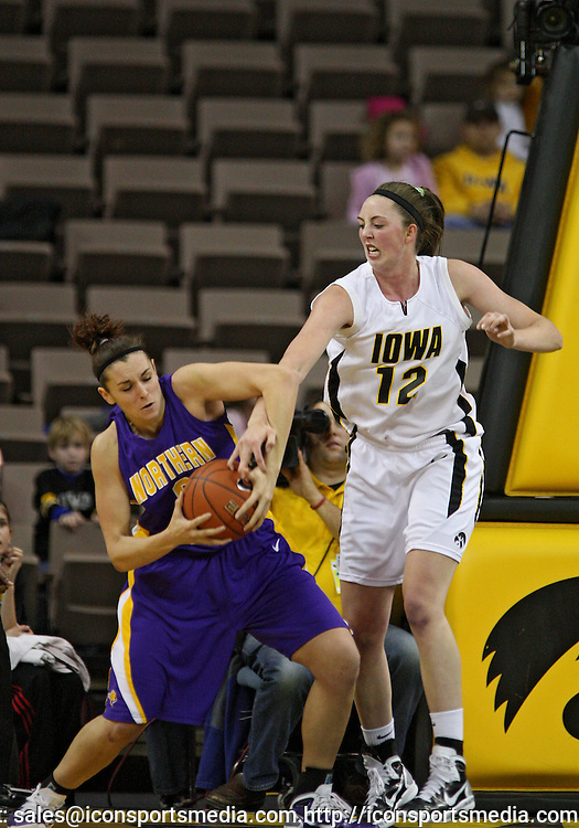 December 22 2010: Northern Iowa forward Amber Kirschbaum (0) and Iowa center Morgan Johnson (12) battle for a rebound during the first half of an NCAA college basketball game at Carver-Hawkeye Arena in Iowa City, Iowa on December 22, 2010. Iowa defeated Northern Iowa 75-64.