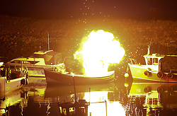 © Licensed to London News Pictures.05/10/15<br /> Redcar, UK. <br /> <br /> A fishing boat explodes and catches fire during controlled filming for the detective drama series 'Vera' which is currently taking place at South Gare near Redcar on Teesside. The series features Brenda Blethyn as DCI Vera Stanhope and is based in the north of England.<br /> <br /> Photo credit : Ian Forsyth/LNP