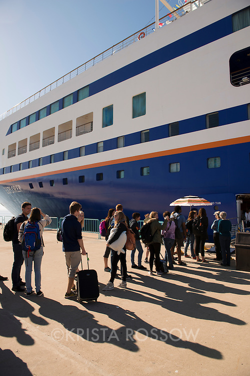 Students line up to board the MV Explorer on Embarkation day for Semester at Sea Spring 2014 Voyage, January 10th 2014, in Ensenada, Mexico.