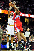 Feb. 11, 2011; Cleveland, OH, USA; Cleveland Cavaliers point guard Mo Williams (2) shoots over Los Angeles Clippers power forward Ike Diogu (50) during the second quarter at Quicken Loans Arena. Mandatory Credit: Jason Miller-US PRESSWIRE