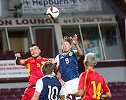 Scotland's Ryan Gauld oujumps FYR Macedonia's Gjoko Zajkov during Scotland Under-21 v FYR Macedonia,  UEFA Under 21 championship qualifier  at Tynecastle, Edinburgh. Photo: David Young<br /> <br />  - © David Young - www.davidyoungphoto.co.uk - email: davidyoungphoto@gmail.com
