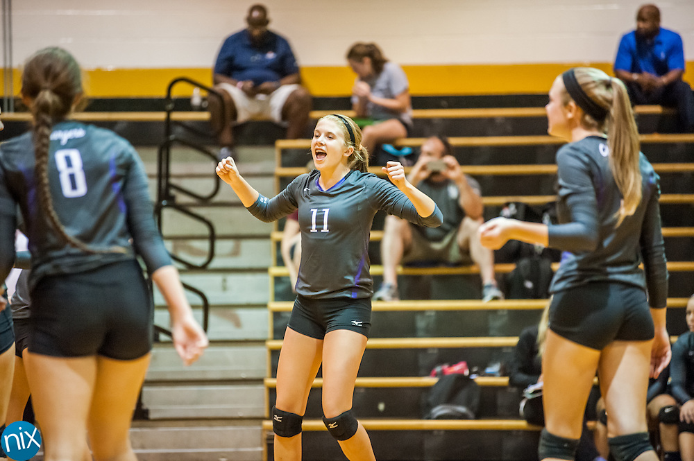 Cox Mill's Courtney Weber (11) celebrates a point with her teammates against Concord Tuesday night at Concord High School.
