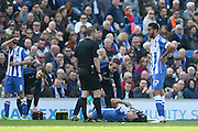 Brighton central midfielder, Beram Kayal (7) lays injured tackled by Burnley midfielder Joey Barton (13) during the Sky Bet Championship match between Brighton and Hove Albion and Burnley at the American Express Community Stadium, Brighton and Hove, England on 2 April 2016. Photo by Phil Duncan.