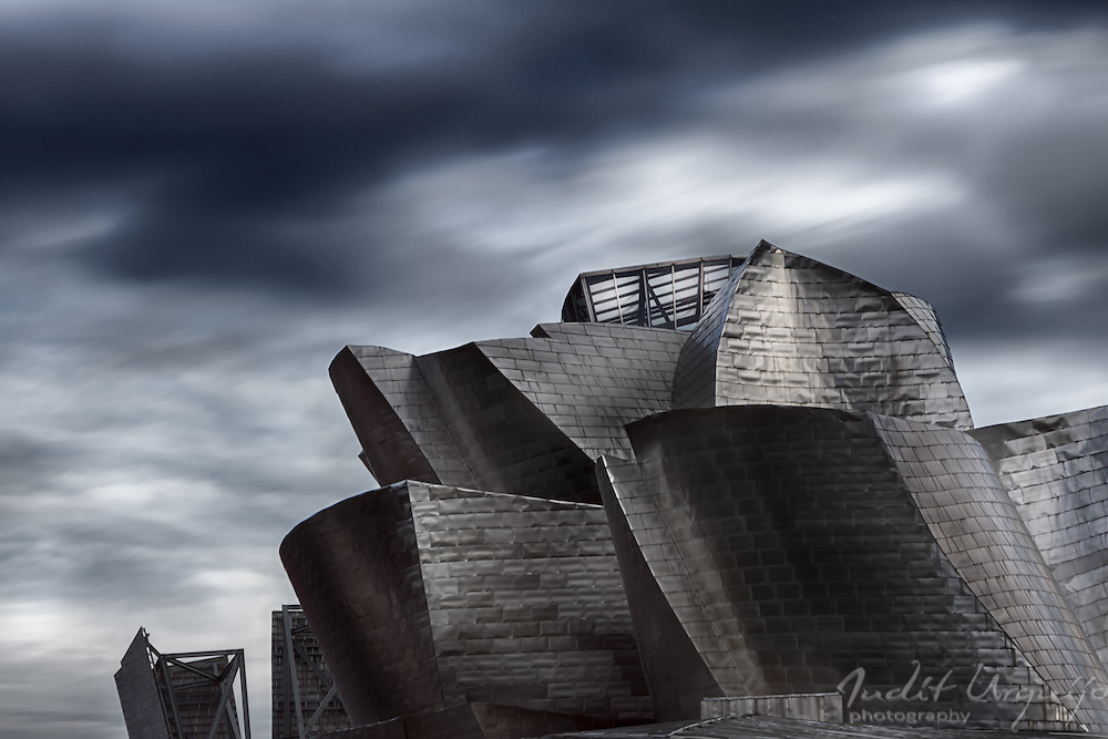 "View of Guggenheim Bilbao museum, designed by architect Frank Gehry. One of the most admired works of contemporary architecture, the building has been hailed as a ""signal moment in the architectural culture""."