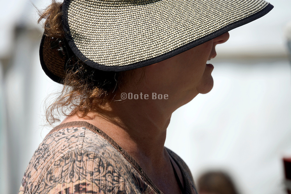 female person with fashionable summer straw cap