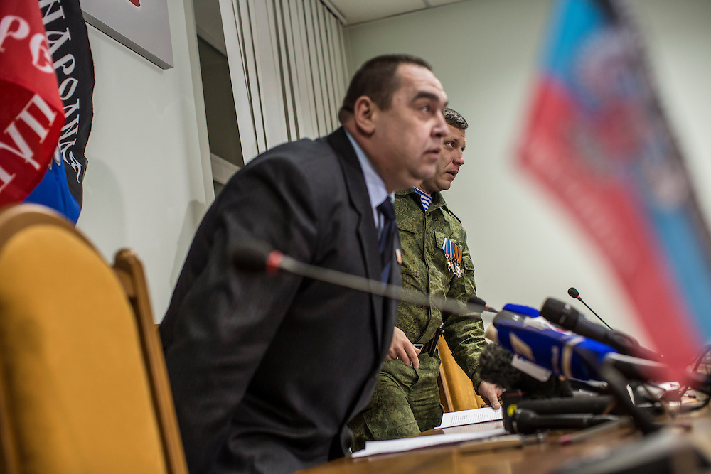 DONETSK, UKRAINE - FEBRUARY 2, 2015: Igor Plotnitsky, left, the head of the Luhansk People's Republic, and Aleksandr Zakharchenko, right, head of the Donetsk People's Republic, arrive for a joint news conference in Donetsk, Ukraine. With peace talks scheduled in the Belarussian capital of Minsk over the weekend that never got underway, the two leaders stated that their representatives refused to participate due to the fact that  Ukraine sent as their representative Leonid Kuchma, a former president of Ukraine with no current government post. CREDIT: Brendan Hoffman for The New York Times