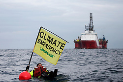 NORTH SEA MYAS 19JUN19 - Greenpeace campaigner Sarah North holds a banner whilst floating in front of BP rig on day 11 of the protest in the North Sea.<br /> <br /> jre/Photo by Jiri Rezac / Greenpeace<br /> <br /> © Jiri Rezac 2019