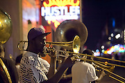 Street Musicians, The Tornado Brass Band, playing in the French Quarter in New Orleans, Louisiana.