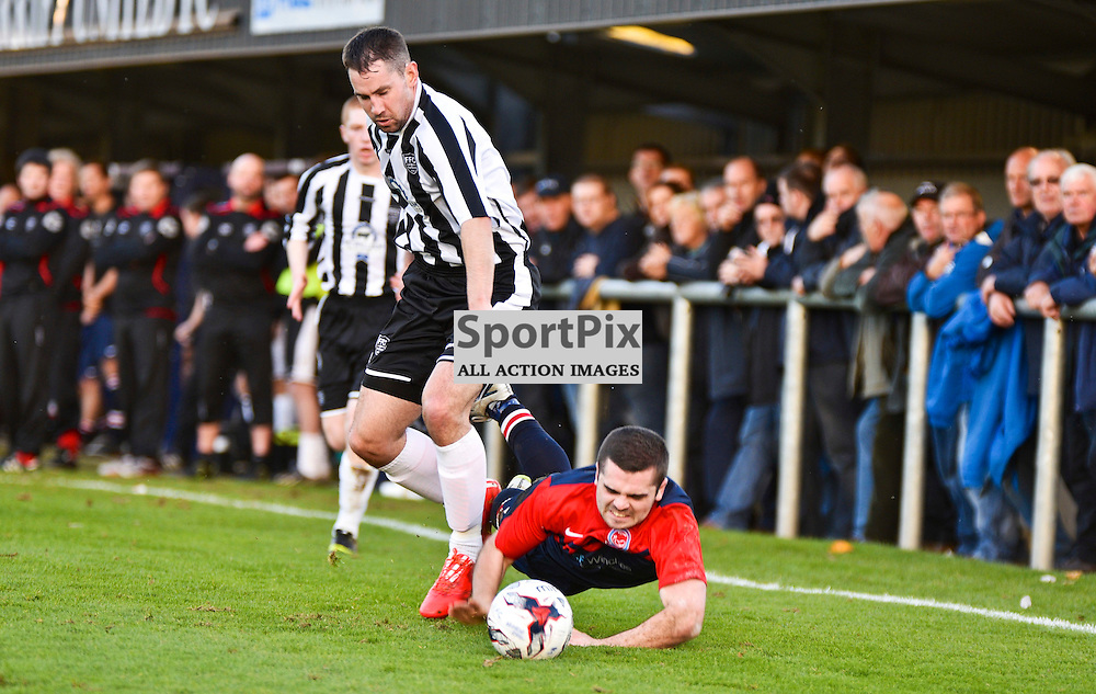 Andrew MacAskill, Turriff United, tumbles after a challenge from Fraserburgh's Marc Dickson in the 2nd Round of Scottish Cup at The Haughs, Turriff. (c) Brian Battensby, SportPix.org.uk