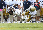 Georgia Tech Yellow Jackets defensive back Jamal Golden (4) upends Georgia Southern Eagles wide receiver Zach Walker (9) during Saturday's college football game at Bobby Dodd Stadium in Atlanta. (Staff Photo: David Welker)