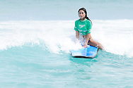 SYDNEY, AUSTRALIA, FEBRUARY 25, 2011: UFC octagon girl Arianny Celeste rides a wave in the surf on Bondi Beach in Sydney, Australia on February 25, 2011.