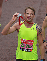 Formula 1 motor racing driver Jenson Button after crossing the line on The Mall to complete her final marathon at the Virgin Money  London Marathon, Sunday 26th April 2015.<br /> <br /> Dillon Bryden for Virgin Money London Marathon<br /> <br /> For more information please contact Penny Dain at pennyd@london-marathon.co.uk