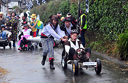&copy; Licensed to London News Pictures.01/01/2018<br /> SUTTON VALENCE, UK.<br /> PIRATE TEAM.<br /> The traditional New Years day Sutton Valence Pram Race in Kent continued this year. In its 38th year the Race was struck by tragedy last year when competitor Francis 'Titch' O' Sullivan tipped over in his spitfire pram and hit his head on the curb, he passed away a day later. A coroners court reported he was not wearing a helmet.<br />  All babies in the pram's have to wear a helmet and the pushers must have contact with the pram and the ground at all times.<br />  <br /> Photo credit: Grant Falvey/LNP