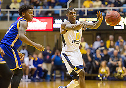Dec 17, 2016; Morgantown, WV, USA; West Virginia Mountaineers guard Teyvon Myers (0) passes the ball during the second half against the UMKC Kangaroos at WVU Coliseum. Mandatory Credit: Ben Queen-USA TODAY Sports