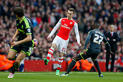 Calum Chambers of Arsenal is challenged by Albert Adomah of Middlesbrough - Photo mandatory by-line: Rogan Thomson/JMP - 07966 386802 - 15/02/2015 - SPORT - FOOTBALL - London, England - Emirates Stadium - Arsenal v Middlesbrough - FA Cup Fifth Round Proper.