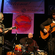 BREVARD, NC - SEPTEMBER 12 : David Grisman (L) performs with his Quintet  - including l-r George Marsh on drums  and Grant Gordy on guitar, and - in the Mountain Song Festival at The Brevard Music Center on September 12, 2009,  in Brevard, North Carolina, USA. (Photo by Logan Mock-Bunting/Getty Images)