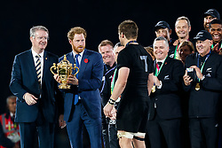 Prince Harry presents the trophy to New Zealand Flanker Richie McCaw (capt) after New Zealand win the match 34-17 to become 2015 World Cup Champions - Mandatory byline: Rogan Thomson/JMP - 07966 386802 - 31/10/2015 - RUGBY UNION - Twickenham Stadium - London, England - New Zealand v Australia - Rugby World Cup 2015 FINAL.