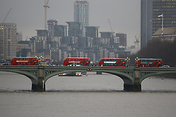 © Licensed to London News Pictures. 09/01/2017. London, UK. Traffic builds up on Westminster Bridge as a 24 hour London Underground tube strike takes hold.  All Zone one tube stations are closed until 6PM tonight after members of the RMT and the Transport Salaried Staffs' Association unions walked out after talks with TFL collapsed.  Photo credit: Peter Macdiarmid/LNP