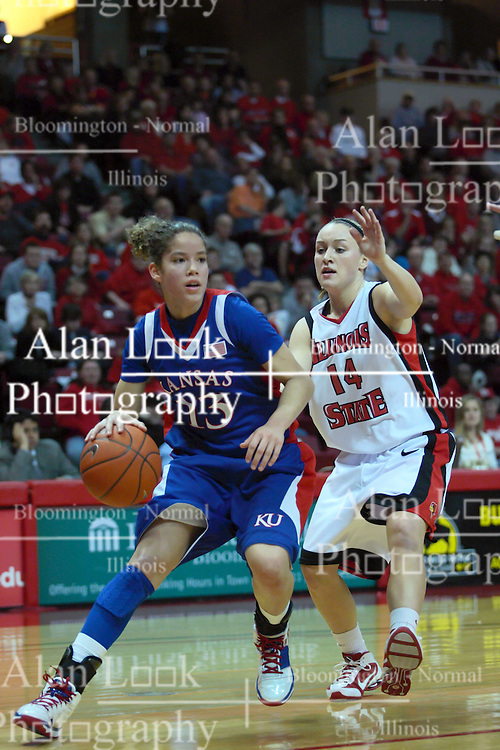 25 March 2010: Monica Engelman rumbles into the lane guarded by Amanda Clifton. The Redbirds of Illinois State crush the Jayhawks of Kansas 71-51 during the 3rd round of the 2010 Women's National Invitational Tournament (WNIT) on Doug Collins Court inside Redbird Arena at Normal Illinois.