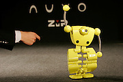 NUVO robot is sold in Japan as a security robot and as a design item. It can monitor the house or the business of his owner by transmitting images to his mobile phone. The owner is also able to direct the robot's movements by remote.