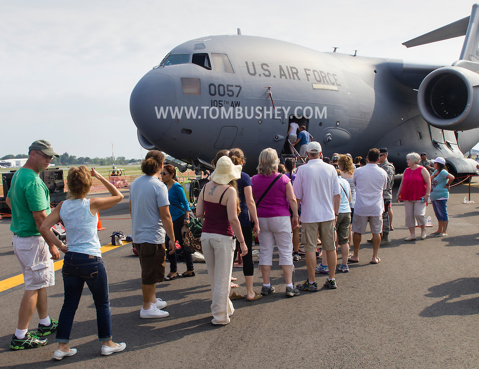 New Windsor, New York - People line up to take a tour inside a C-17 Globemaster II on display at the New York Air Show at Stewart International Airport on Aug. 30, 2015. ©Tom Bushey / The Image Works