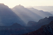 Sunrise, sun streaming through clouds, Mather Point, Grand Canyon National Park, Arizona...Subject photograph(s) are copyright Edward McCain. All rights are reserved except those specifically granted by Edward McCain in writing prior to publication...McCain Photography.211 S 4th Avenue.Tucson, AZ 85701-2103.(520) 623-1998.mobile: (520) 990-0999.fax: (520) 623-1190.http://www.mccainphoto.com.edward@mccainphoto.com.