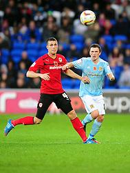 Hull City's Corry Evans battles for the ball with Cardiff City's Filip Kiss - Photo mandatory by-line: Joe Meredith/JMP  - Tel: Mobile:07966 386802 10/11/2012 - SPORT - FOOTBALL - Championship   -   Cardiff  -  New Cardiff City Stadium  -  Cardiff City v Hull City