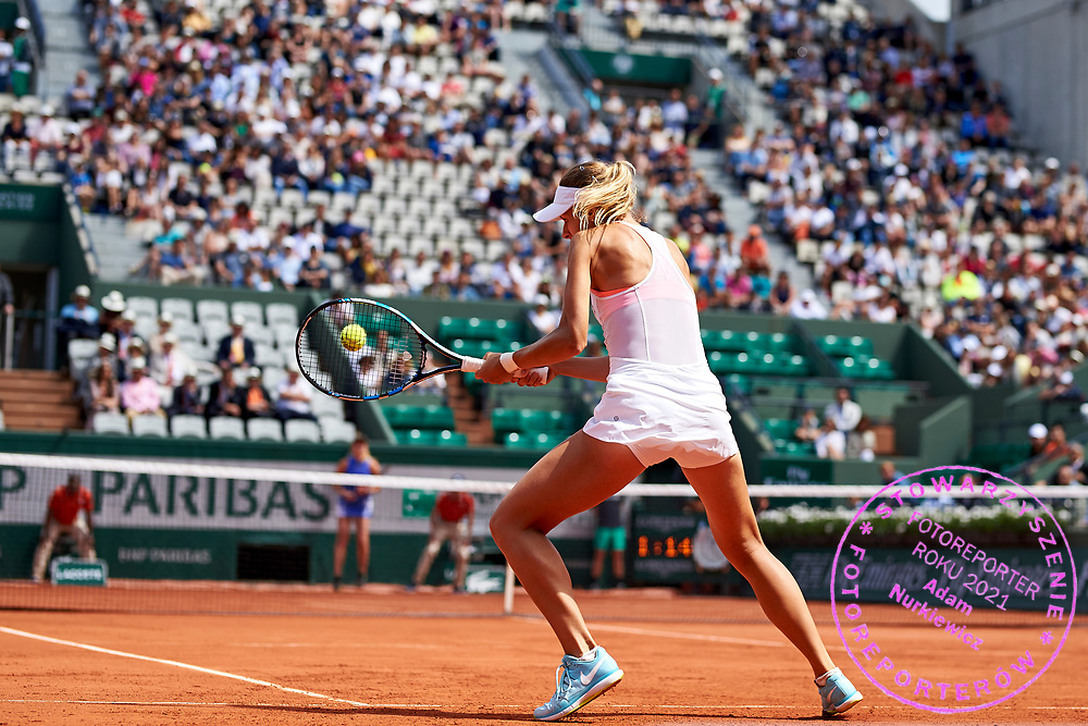 Paris, France - 2017 June 04: Magda Linette from Poland plays a backhand during her women's single match third round during tennis Grand Slam tournament The French Open 2017 (also called Roland Garros) at Stade Roland Garros on June 04, 2017 in Paris, France.<br /> <br /> Mandatory credit:<br /> Photo by &copy; Adam Nurkiewicz<br /> <br /> Adam Nurkiewicz declares that he has no rights to the image of people at the photographs of his authorship.<br /> <br /> Picture also available in RAW (NEF) or TIFF format on special request.<br /> <br /> Any editorial, commercial or promotional use requires written permission from the author of image.